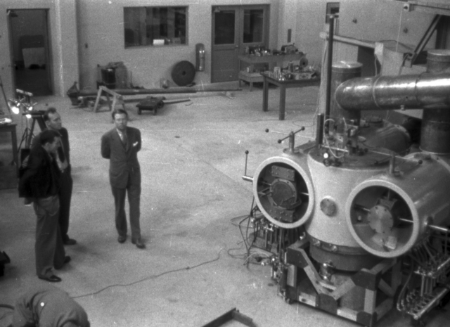 Ernest Orlando Lawrence (right) and two unidentified individuals at 60-inch cyclotron tanks.  Cooksey  31-11, April 1, 1939. [Photographer: Donald Cooksey]