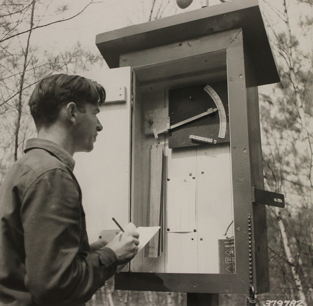 Civilian Conservation Corps (CCC) Enrollee Checks Moisture Content Strips at Fire Weather Station at Thronton CCC Camp