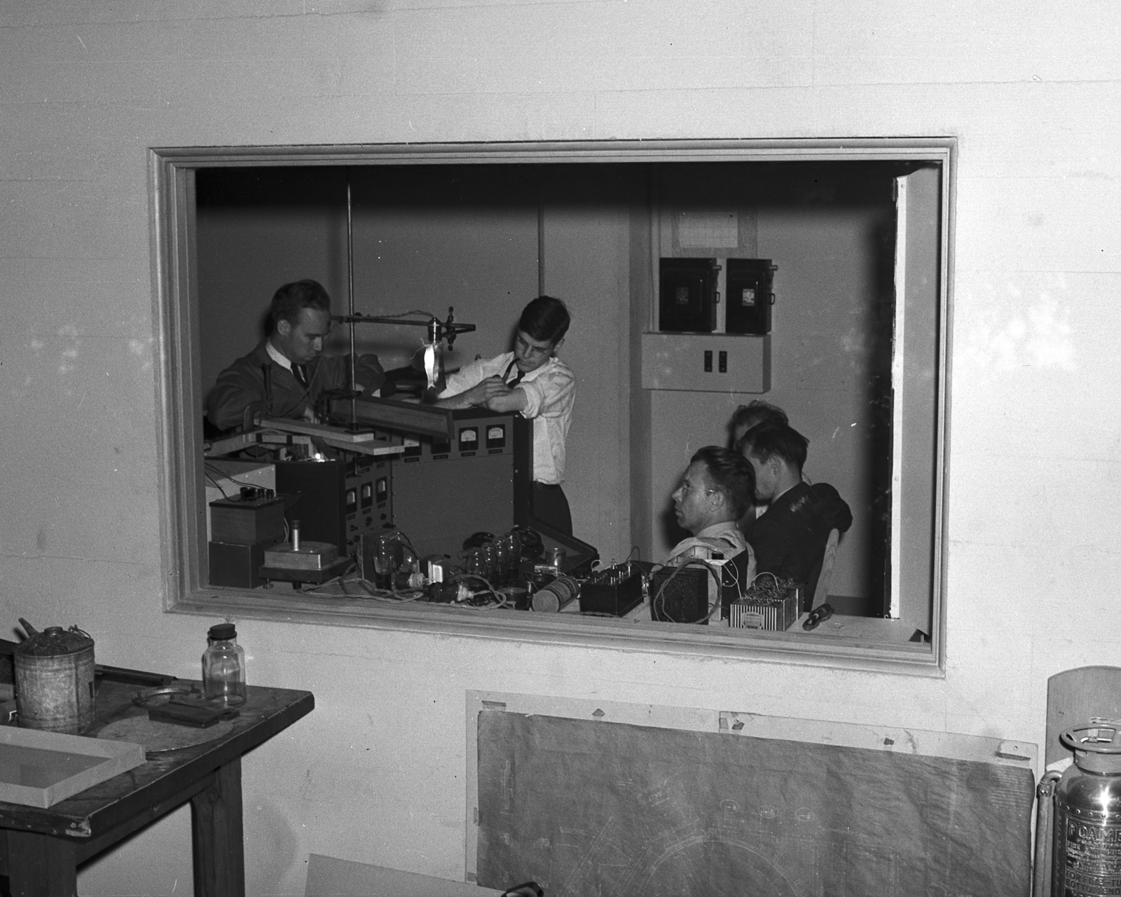 Control room window. Bill Brobeck, Wilson, Ernest Orlando Lawrence, Salisbury, and Edwin McMillan. June 12 ,1939. Cooksey 21 [Photographer: Donald Cooksey]