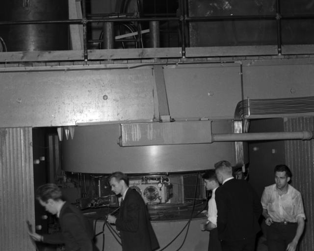 Raymond, Edwin McMillan, Robert Wilson, David Sloan, and Bill Farley at 60-inch cyclotron target side, June 12, 1939. Cooksey 18 [Photographer: Donald Cooksey]