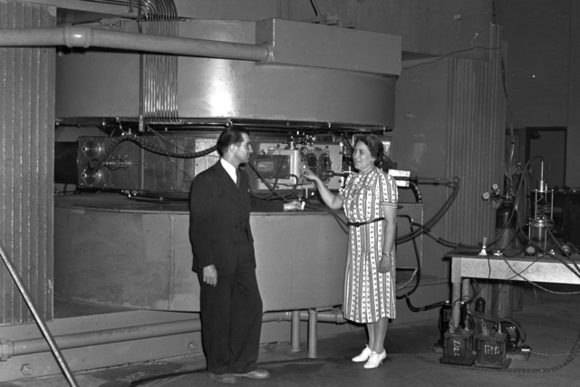 Paul Aebersold and Gladys Anslow at the 60-inch cyclotron, August 26, 1939. Dr. Anslow, a physicist was the first woman to work on the 8MeV cyclotron at Berkeley and was one of the few women involved with the Manhatten Project. Cooksey 48 [Photographer: Donald Cooksey]