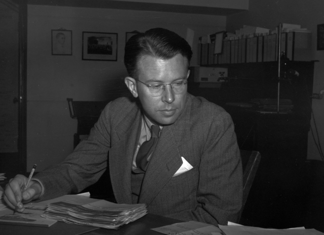 "Ernest Orlando Lawrence sitting at his desk with pencil in hand, referenced as ""best picture given to Walke,"" taken November 15, 1939. See also: XBD200106-00940.tif Principal Investigator/Project: Analog Conversion Project [Photographer: Donald Cooksey]"