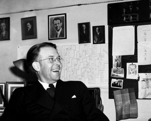 Smiling Ernest Orlando Lawrence in his office dated November 22, 1939. See negative Morgue 1958-8 (P-65); Cooksey 122 [Photographer: Donald Cooksey]
