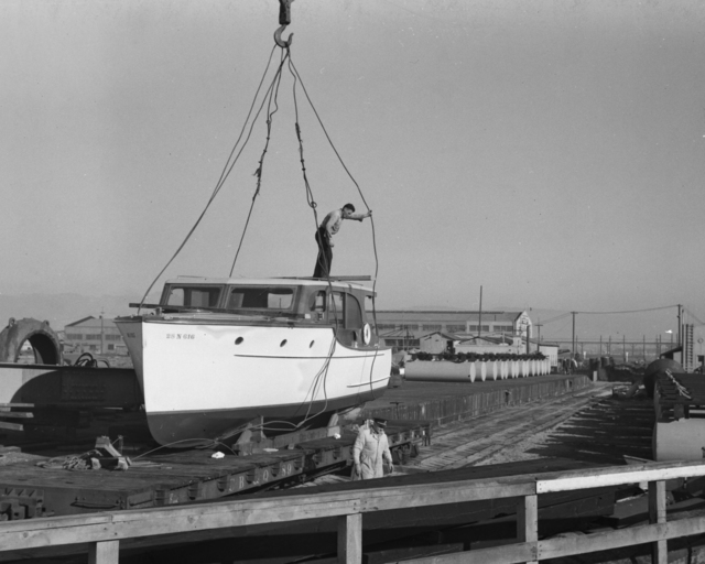 Ernest Orlando Lawrence's boat, the Delta Ray, on railroad car. Photo taken November 27, 1939.  Principal Investigator/Project: Analog Conversion Project [Photographer: Donald Cooksey]