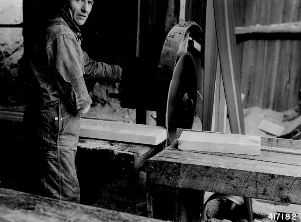 Photograph of a Board Being Cut at a Mill