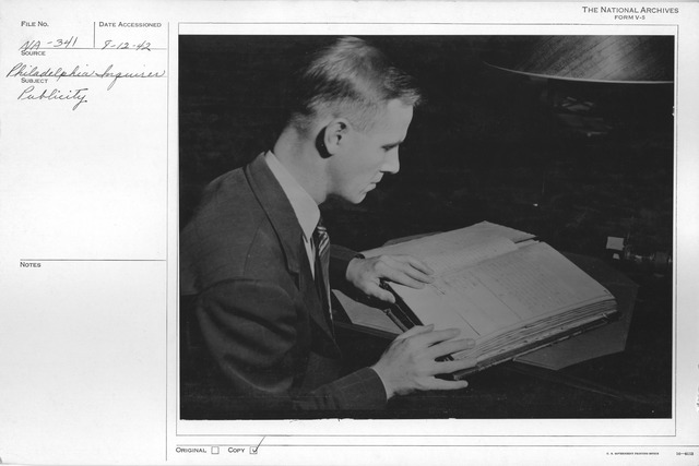 Photograph of Edwin R. Flatequal Studying District of Columbia Land Agreements in Records of the Department of the Interior at the National Archives