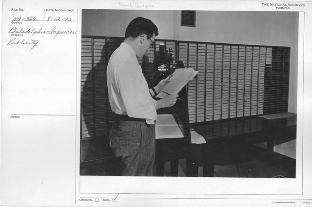 Photograph of Frank E. Bridgers, Jr. With Microfilm Index for Veterans' Administration Records