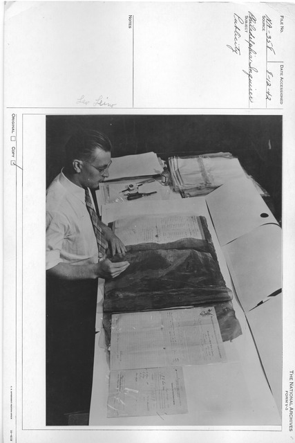 Photograph of Leo Leino Coating Documents with Cellulose Sheets, Repair and Preservation Division