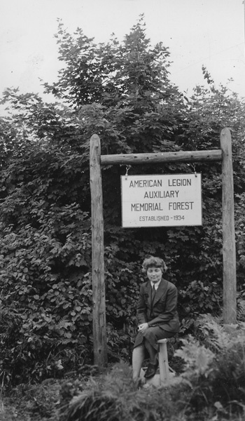 Photograph of Miss March-Mount at Sign for American Legion Auxiliary Memorial Forest