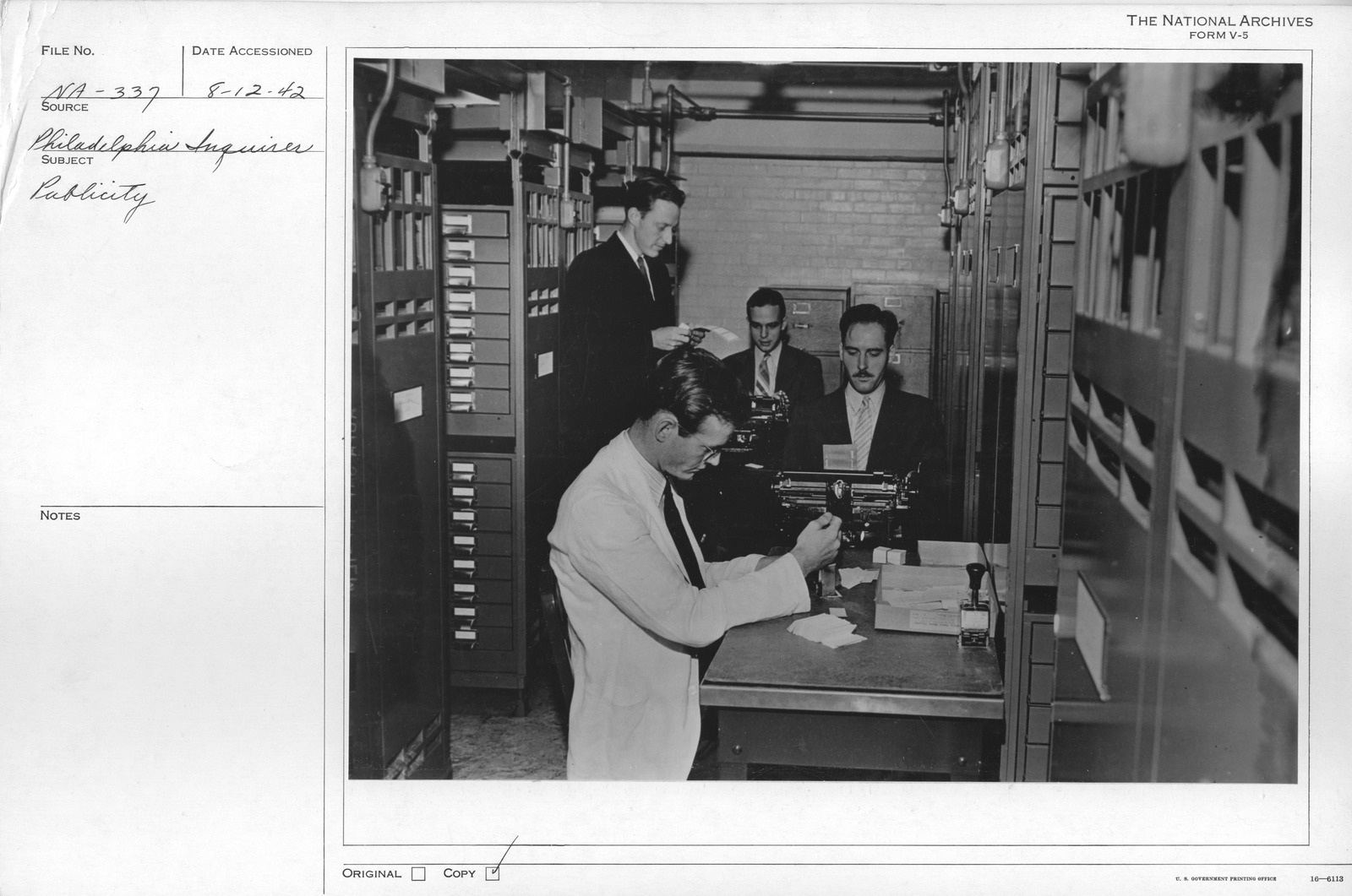 Photograph of Staff Members Labeling Records