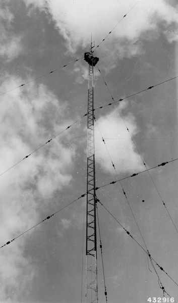 """Photograph of Tower Men Installing and Adjusting """"J"""" Type Antenna"""