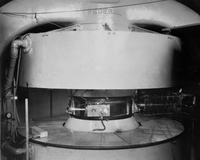 75-ton 37-inch deuteron beam out. The Federal Telegraph magnet shown with new 37-inch pole tips. A beam of deuterons of about 6.3 meV. is seen coming from the target chamber,  taken February 1, 1940. Principal Investigator/Project: Analog Conversion Project [Photographer: Donald Cooksey]