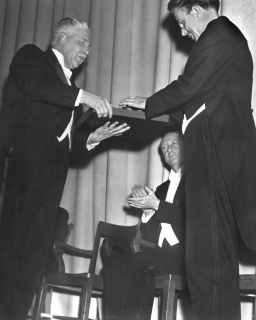 The March 1,1940 Nobel Award ceremony for Ernest Orlando Lawrence at Wheeler Hall on the University of California, Berkeley campus. Awarding the prize is Swedish Consul General with U.C. President Robert Sproul looking on. The war prevented the trip to Stockholm. Morgue 1958-8 (P-25) [Photographer: Donald Cooksey]