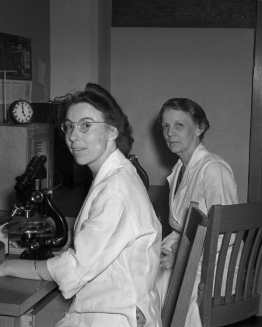 Margaret Lewis (left), and Margaret Reed Lewis (right) with microscopes, taken March 25, 1940. Principal Investigator/Project: Analog Conversion Project [Photographer: Donald Cooksey]