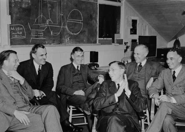 Meeting in the Radiation Laboratory on the University of California, Berkeley (UCB) campus to discuss the 184-inch cyclotron. Left to right: Ernest O. Lawrence, Arthur H. Compton, Vannevar Bush, James B. Conant, Karl T. Compton, and Alfred Loomis, March 29, 1940. Morgue 1958-8 (P-40). [Photographer: Donald Cooksey]