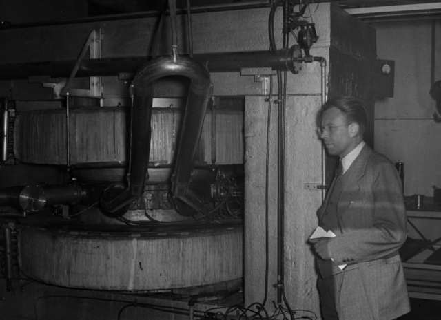 Ernest Orlando Lawrence standing beside the cyclotron at Purdue University. Photo taken April 20, 1940. Principal Investigator/Project: Analog Conversion Project [Photographer: Donald Cooksey]