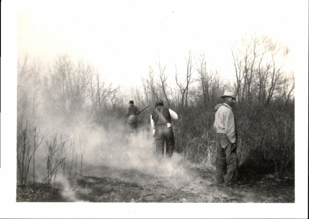 Men Burning a Field