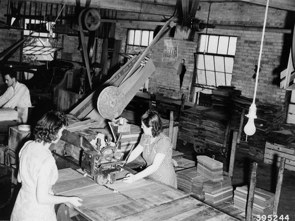 Photograph of Taping Walnut Veneer Strips