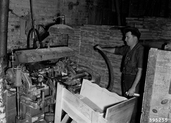Photograph of Worker Operating a Lathe