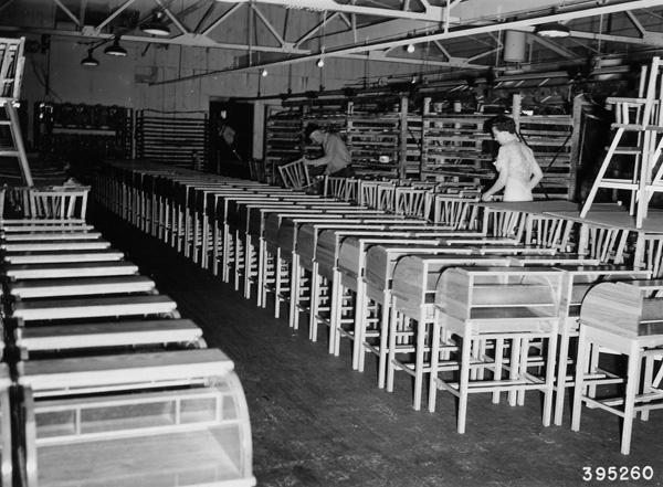 Photograph of Workers Inspecting Child's Desks and High Chairs