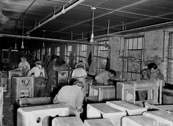 Photograph of Workers Sanding the Radio Cabinets