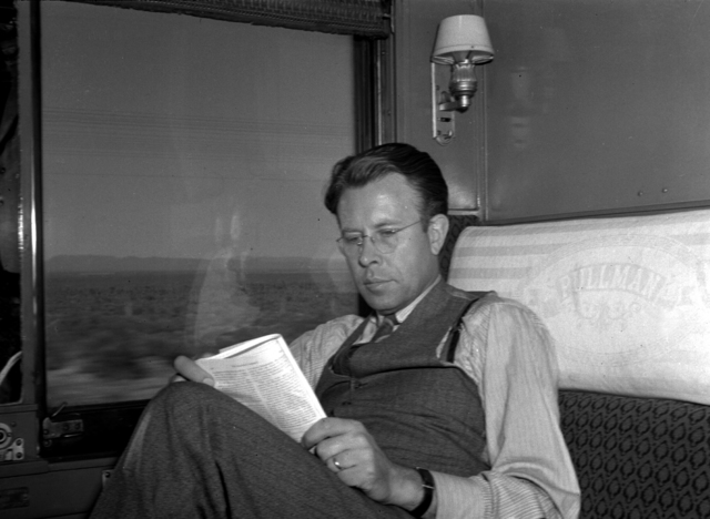Ernest Orlando Lawrence reading in Pullman train compartment while crossing Nevada. Negative envelope dated May 8, 1940. Principal Investigator/Project: Analog Conversion Project [Photographer: Donald Cooksey]