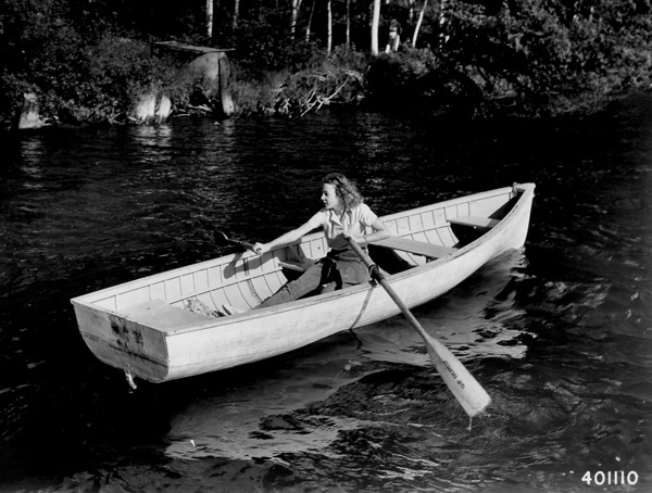 Photograph of Mary Morwood of Alton, Illinois, Rowing in One of the Bays in North Star Lake