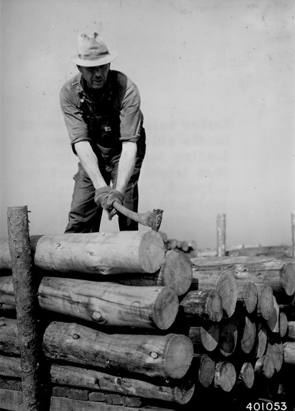 Photograph of Worker Using a Pickaroon to Handle Sticks of Pulpwood