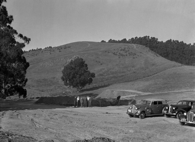 184-inch cyclotron construction site with Ernest Orlando Lawrence and others. Lawrence's Packard in foreground.  Shot taken on September 25, 1940. Principal Investigator/Project: Analog Conversion Project [Photographer: Donald Cooksey]