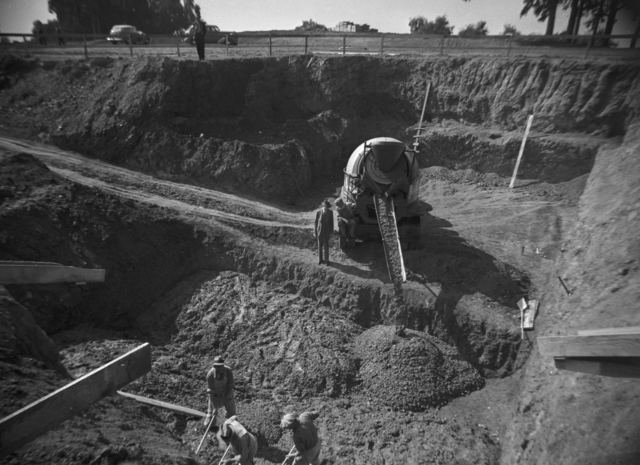 184-inch magnet 5 ft. thick subfoundation being poured (east end of excavation pit), taken October 8, 1940. Principal Investigator/Project: Analog Conversion Project [Photographer: Donald Cooksey]