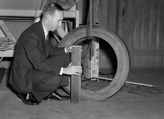 Bill Brobeck with184-inch magnet copper sample from Phelps Dodge Copper Products Corporation, taken October 17, 1940. Principal Investigator/Project: Analog Conversion Project [Photographer: Donald Cooksey]