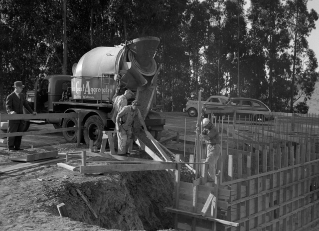 184-inch magnet foundation. Pouring concrete into the base, taken October 18, 1940. Principal Investigator/Project: Analog Conversion Project [Photographer: Donald Cooksey]