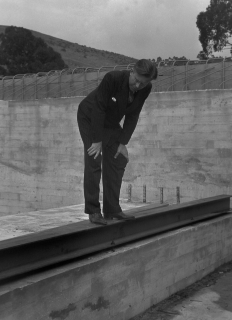 Ernest Orlando Lawrence standing on 184-inch magnet foundation west rail, taken October 28, 1940. Principal Investigator/Project: Analog Conversion Project [Photographer: Donald Cooksey]