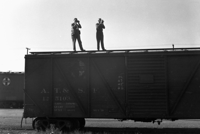 Bill Farley and Donald Cooksey on Santa Fe railcar, taken November 19, 1940. Principal Investigator/Project: Analog Conversion Project [Photographer: Donald Cooksey]
