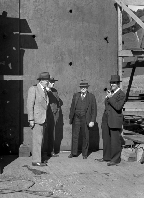 Individuals, including Lawrence Kruse (left) and Arthur Brown, Jr. (second from left), at 184-inch cyclotron construction site, taken March 20, 1941. Principal Investigator/Project: Analog Conversion Project [Photographer: Donald Cooksey]