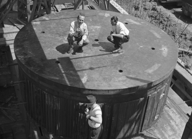 Joseph Hamilton (left) and Paul Aebersold on lower core of 184-inch cyclotron with Bill Twitchell working below, taken May 15, 1941. Principal Investigator/Project: Analog Conversion Project [Photographer: Donald Cooksey]