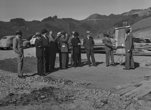Grounds and Buildings Committee of the Regents of the University of California  inspecting 184-inch cyclotron construction progress. Ernest Orlando Lawrence facing camera with Robert G. Sproul to his right. Photo taken May 21, 1941. Principal Investigator/Project: Analog Conversion Project [Photographer: Donald Cooksey]