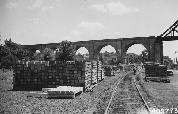 Photograph of Ties Piled Along Railway Tracks
