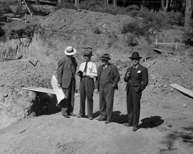 Wallace B. Reynolds (second from left); Arthur Brown Jr. (third from left), contractor; and Lawrence Kruse (right) at the Medical Physics Laboratory construction site, taken August 12, 1941. Principal Investigator/Project: Analog Conversion Project [Photographer: Donald Cooksey]