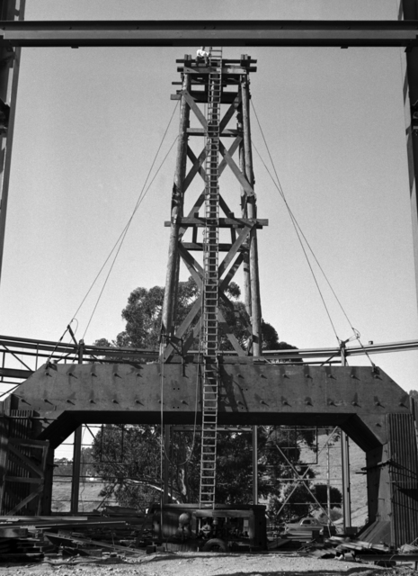 184-inch cyclotron construction site showing tower for central roof ring. Bill Twitchell sitting on top, taken October 14, 1941. Principal Investigator/Project: Analog Conversion Project [Photographer: Donald Cooksey]