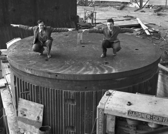 "Arnold Clark (left) and ""Fuzzy"" Wooters on lower core of 184-inch cyclotron, taken November 14, 1941. Principal Investigator/Project: Analog Conversion Project [Photographer: Donald Cooksey]"