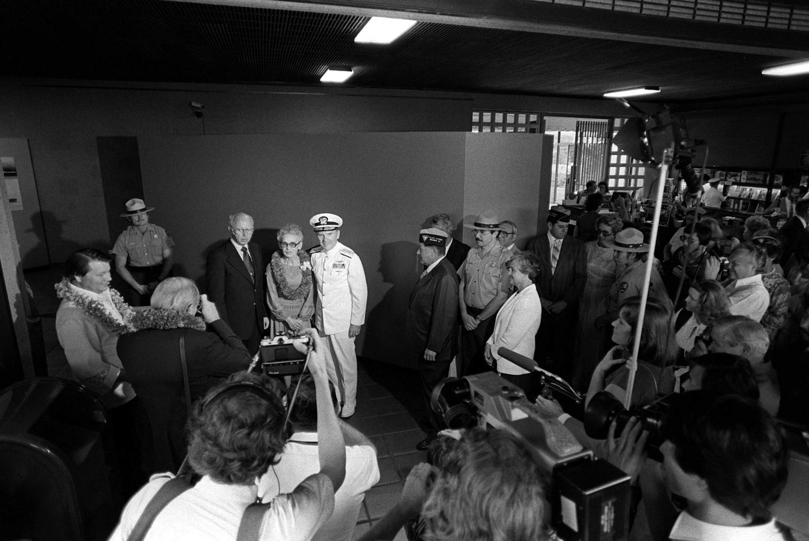 Joseph and Edith Susnir and RADM Stanley J. Anderson, commander, Naval Base, Pearl Harbor, prepare to cut the ribbon during ceremonies to mark the opening of the shoreside visitors center for the new USS ARIZONA Memorial Museum