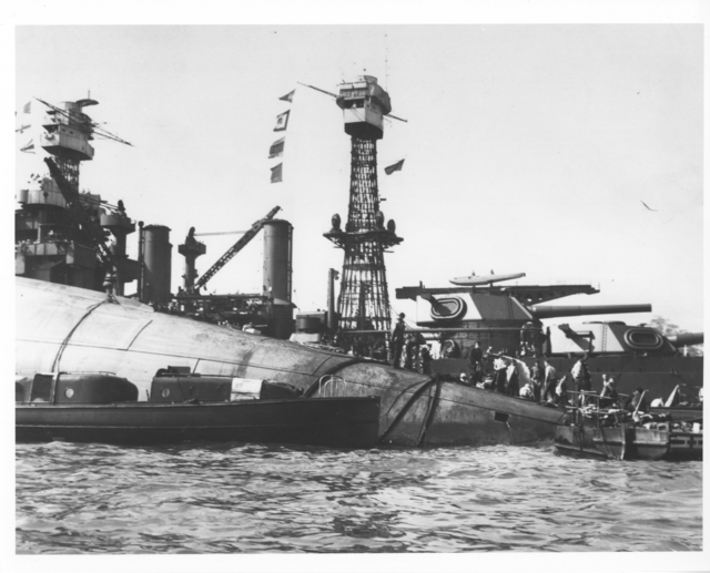 Photograph of the Capsized USS Oklahoma and the USS Maryland after the Japanese Attack on Pearl Harbor