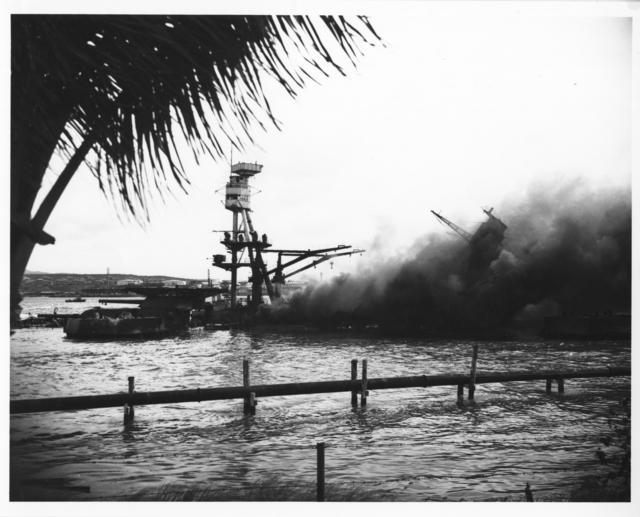 Photograph of the Capsized USS Utah and the USS Raleigh in the Background after the Japanese Attack on Pearl Harbor
