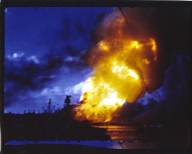 Photograph of USS Arizona Burns at Pearl Harbor after Japanese Attack