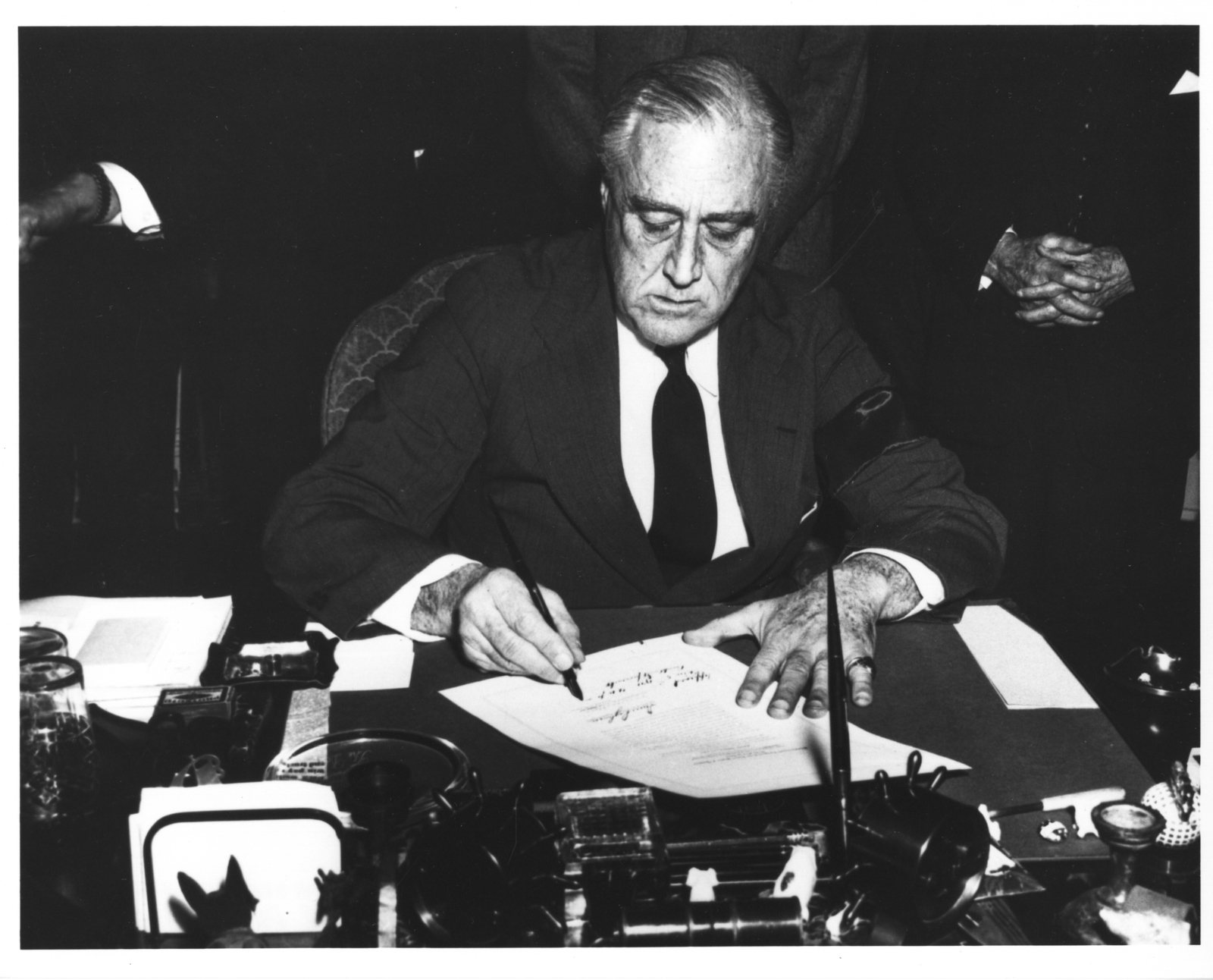 Photograph of President Franklin D. Roosevelt Signing the Declaration of War Against Japan