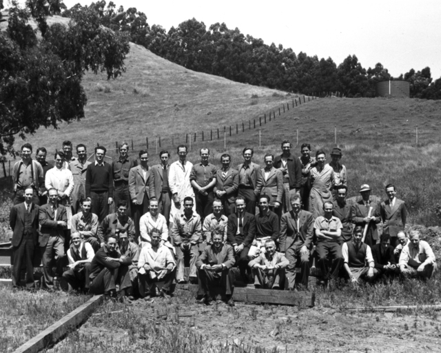 Ernest Orlando Lawrence (front row center) and group on the future site of the 184-inch cyclotron. Group includes many significant individuals from the early Rad Lab days, dated 1942. Morgue 1944-87 (P-1) [Photographer: Donald Cooksey]