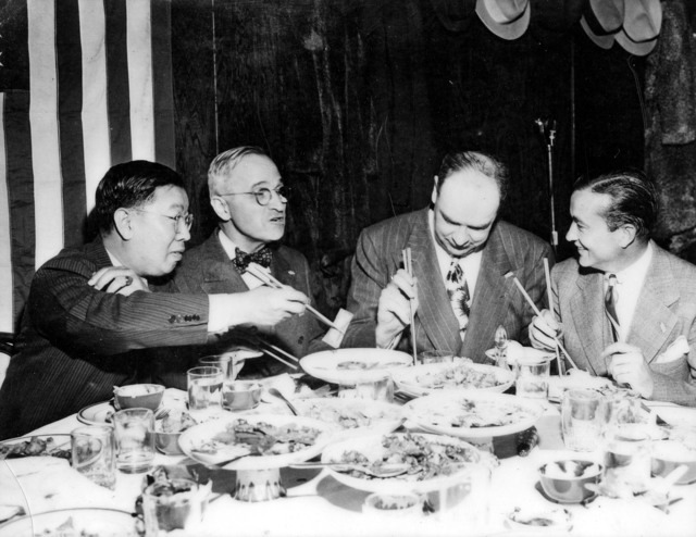 Senator Harry S. Truman and Others Eating Chinese Food