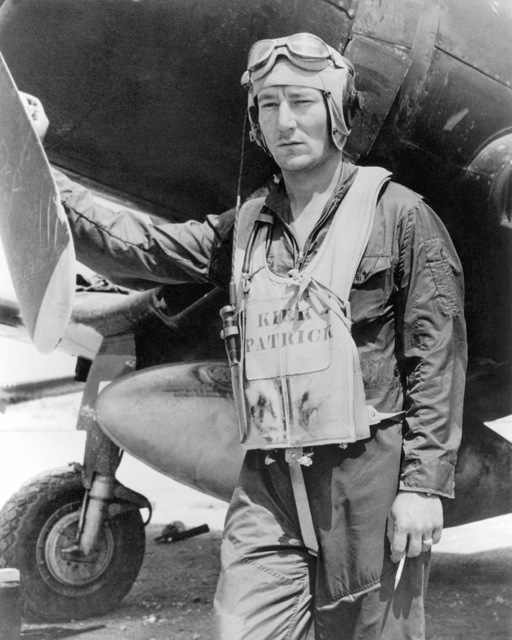 United States Marine Corps Captain (CPT) Floyd C. Kirkpatrick.  Shown here beside his F4U Corsair, on Okinawa.  Official Portrait