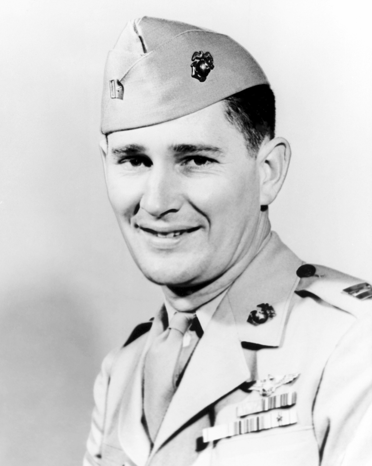 United States Marine Corps Captain (CPT) Joseph Jacob Foss, is shown wearing the highly prized Medal of Honor bestowed upon him by President Roosevelt for outstanding gallantry against the Japanese in the Solomons. Official Portrait